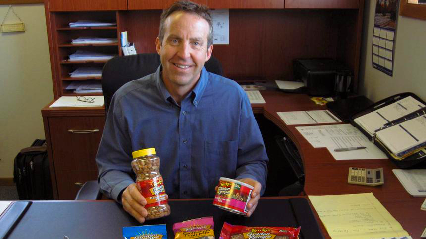 Tom Taunton, vice president and general manager of Gurley's Foods in Willmar, shows off an assortment of the roasted nuts that have helped put the company's name on products that can be found coast to coast across the United States. (Tribune photo by Anne Polta)